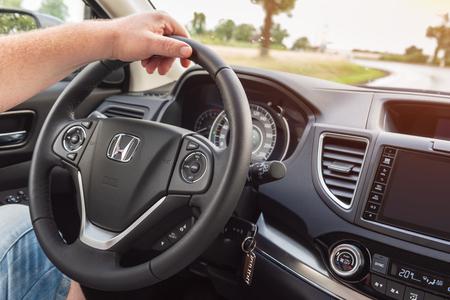 POLAND - July 13, 2018: Man driving Honda CR-V.