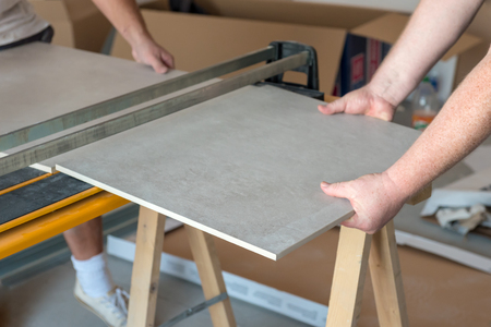 Workers Cutting Ceramic Floor Tiles Tile With Tile Cutter Stock
