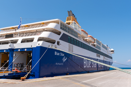 RHODES, GREECE - May 13, 2018: Blue Star Ferries is docked at wharf in Mandrakia port of Rhodes. Dodecanese, Rhodes island, Greece