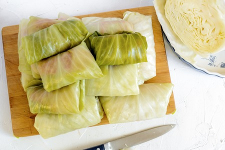 Cabbage rolls stuffed with meat and rice prepared for cooking. Stock fotó