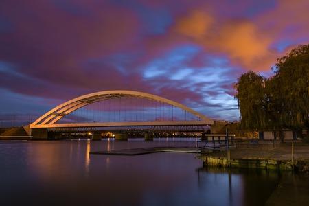 Railway bridge over Martwa Wisla river at night in Gdansk. Poland Europe.