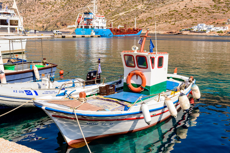 SIFNOS, GREECE - September 10, 2018: Fishing boat in the port of Kamares. Sifnos island, Greece