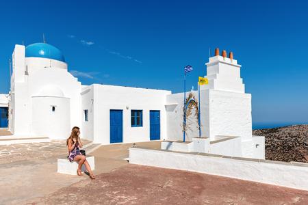 Young woman enjoying holidays in Greece. Sifnos island, Cyclades, Greece