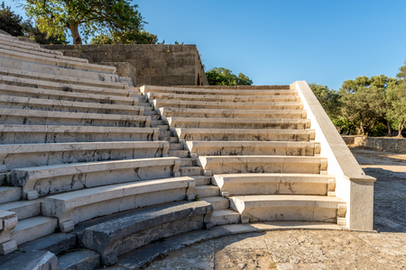 Ancient theater with marble seats and stairs. The Acropolis of Rhodes. Rhodes island, Greece