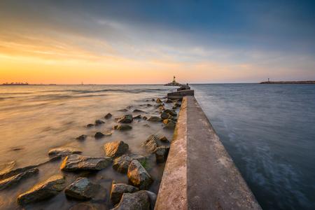 Breakwater, entrance to the port of Gdansk, Górki Zachodnie, during sunset. Baltic Sea, Poland Stock Photo