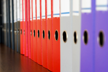 A row of binders for documents in the office