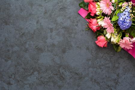 Festive flower composition on black background. Copy space