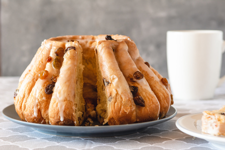 Traditional yeast ring cake with icing and raisins.