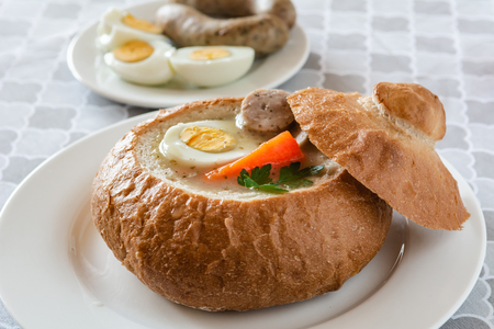 The sour soup (zurek) made of rye flour and sausage. Popular Easter dish. Stock Photo