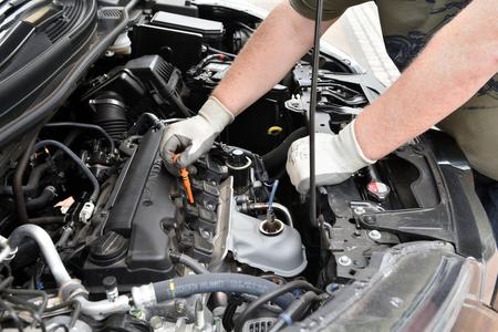BEDZIN, POLAND - July 15, 2019: Man checking oil level in Honda CR-V car engine. Editorial