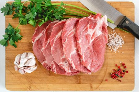 Raw pork neck meat cuts with spices