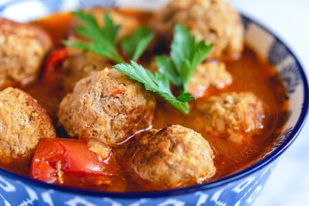 Pork and beef meatballs in tomato and paprika sauce Imagens