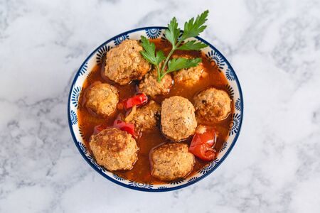 Pork and beef meatballs in tomato and paprika sauce Stok Fotoğraf - 130067912
