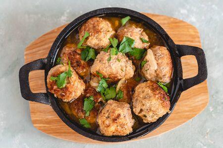 Homemade pork and beef meatballs in gravy