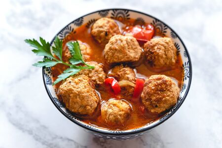 Pork and beef meatballs in tomato and paprika sauce Stok Fotoğraf - 130067915