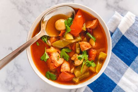 Letcho with yellow and red pepper, zucchini, tomatoes and mushrooms served in a bowl