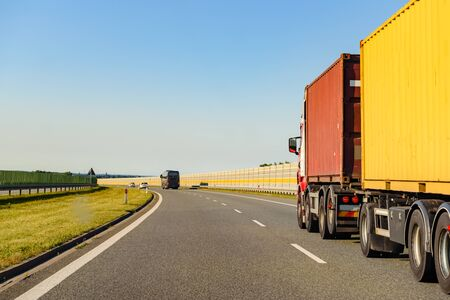 Freight truck on a highway in a rural landscape