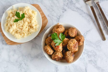 Pork meatballs in tomato sauce served with couscous Imagens