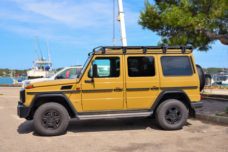Mallorca, Spain - May 9, 2019: Yellow Mercedes Benz G-Class parked on the street