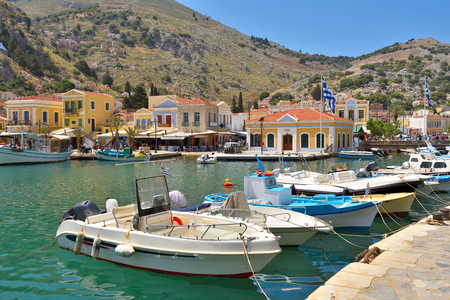 Boats moored in the bay of the island of Symi, Dodecanese, Greece Editöryel