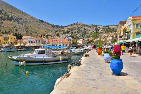 SYMI, GREECE - May 15, 2018: Seaside promenade on beatiful Symi island, Greece