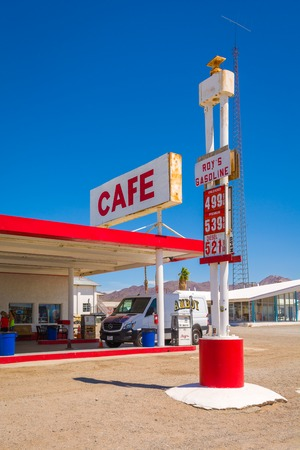 CALIFORNIA, USA - April 9, 2019: Gas station with cafe sign along historic Route 66 road in Californian desert. United States