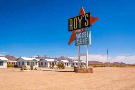 CALIFORNIA, USA - April 9, 2019: Roys motel and cafe with vintage neon sign on historic Route 66 road in Californian desert. United States