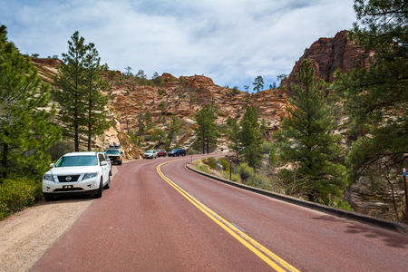 Utah, USA - April 7,2019: Road through the Zion National Park. Landscape of rock hills and trees. Utah, USA Stock fotó - 133524756