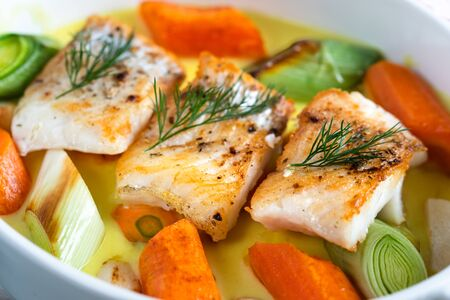Cod fish baked with vegetables in a lemon sauce.