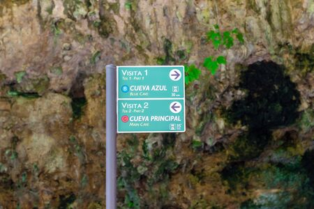 Mallorca, Spain - May 9, 2019: Signpost in Coves dels Hams - one of the most popular caves located on Mallorca. Spain Stok Fotoğraf