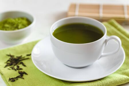 Green tea matcha in a white cup Stok Fotoğraf