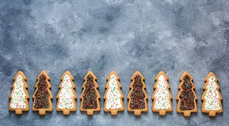 Christmas background with cookies. Christmas trees. Flat lay Stok Fotoğraf