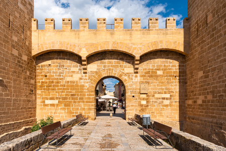 Mallorca, Spain - May 10,2019: Porta de Sant Sebastia, gate to the old town of Alcudia, Mallorca Redakční