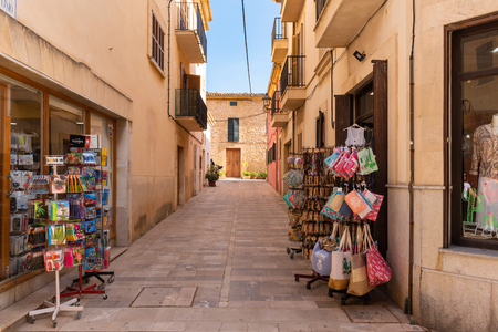Mallorca, Spain - May 10,2019: Street with shops on street in Alcudia Old Town in Majorca.