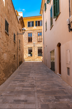 Mallorca, Spain - May 10,2019: Narrow street in the old town of Alcudia, Mallorca Redakční