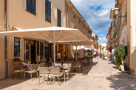 Mallorca, Spain - May 10,2019: Restaurant on street in Alcudia Old town, Mallorca Redakční