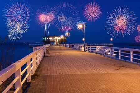 Happy New Year fireworks over Baltic Sea at the pier in Puck. Poland