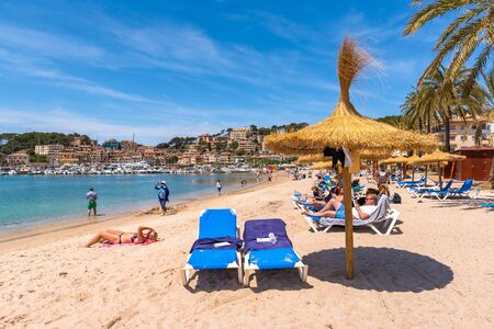 Beach in Port de Soller, Majorca seaside resort, a popular tourist destination. Baleares, Spain