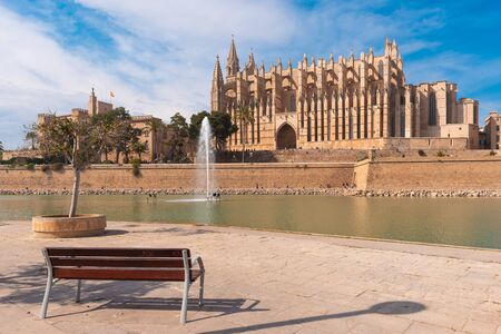 Bench on the promenade overlooking La Seu, the gothic cathedral de Santa María de Palma de Mallorca. Spain