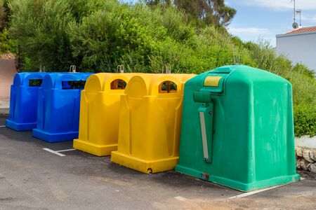 A row of colorful dustbins for waste segregation. Banque d'images