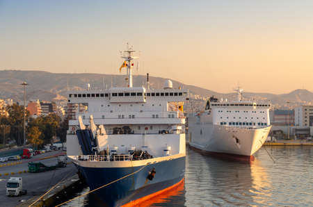 Ferries are docking at the port of Piraeus, Greece.