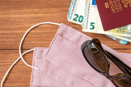 Virus protective mask and international Polish passport. Travel concept, tourism care, corona virus disease. Archivio Fotografico