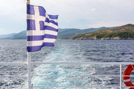 Greek on an open deck of a ferryboat in sunny summer day. Greece Standard-Bild