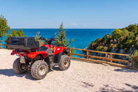 Zakynthos, Greece - October 2, 2017: Quad parked on the coast of Zakynthos. Quad is very popular means of transport in Greece.