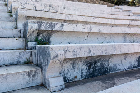 Marble seats in ancient theater in the Acropolis of Rhodes. Rhodes island, Greece