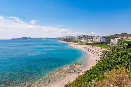 View of bay with sandy beach in Faliraki. Rhodes island, Dodecanese, Greece.