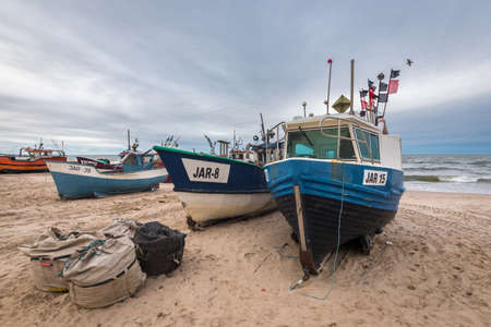 Jaroslawiec, Poland - October 31, 2016: Fishing boats on the beach of the Baltic Sea. Editorial