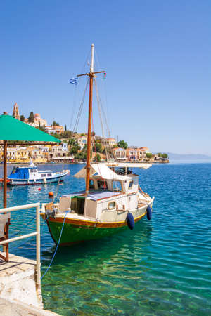 SYMI, GREECE - May 15, 2018: Clock tower in harbor of Symi island, Dodecanese, Greece