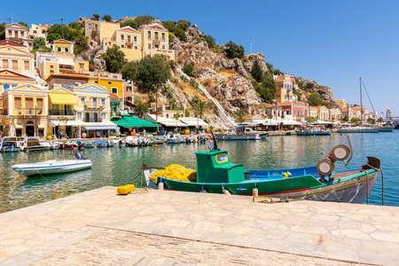 SYMI, GREECE - May 15, 2018: Beautiful Symi island with colorful architecture and beautiful bay, Dodecanese, Greece