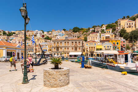SYMI, GREECE - May 15, 2018: Main square on Symi island with colorful architecture, Dodecanese, Greece